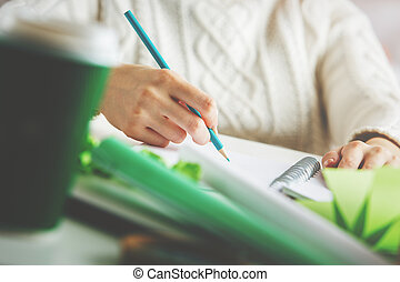 Female writing in notepad