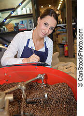 female writing notes about the quality of the beans