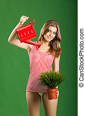 Female young gardener - happy sexy female gardener over a...