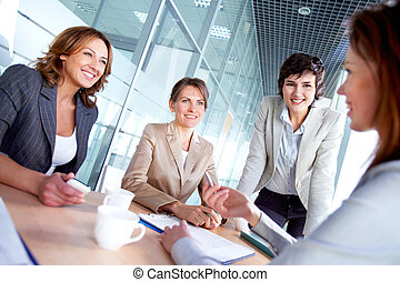 Females at meeting - Image of successful females listening...