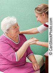females blonde nurse makes a visit