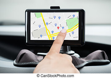 Female's Hand Using GPS Navigation
