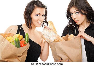 females holding shooping bags groceries