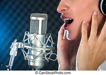 Female's Open Mouth With Red Lipstick In Front Of Microphone