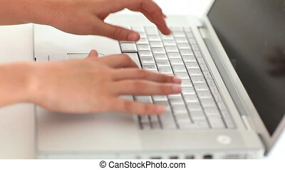 Femine hands typing