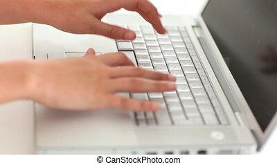 Femine hands typing