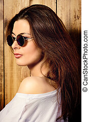 feminine appearance - Attractive young woman in sunglasses...