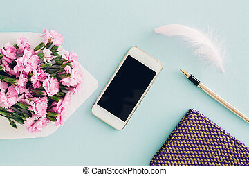 feminine flat lay on blue background, top view of woman's ...