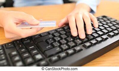 Feminine hands buying on the intern