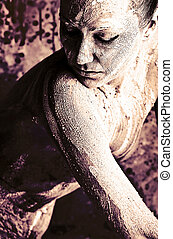 feminine - Portrait of an artistic woman painted with clay....