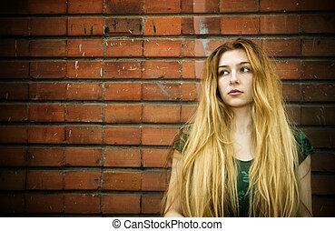 Feminine sadness - Portrait of sad woman standing against...