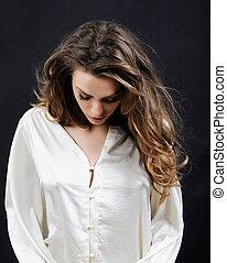 Feminine sensitive emotional woman in lace in the studio