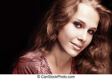 Feminine sensual woman with beautiful hair
