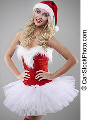 Feminine St.claus with hands on hips