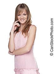 Feminine teen girl in pink dress smiling