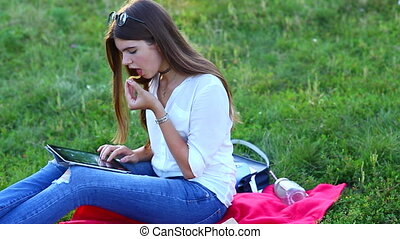 feminine working outdoors with papers in glasses. in the park fa