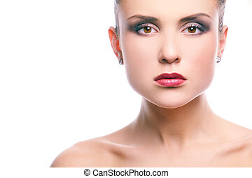 Image of gorgeous woman with perfect makeup looking at camera