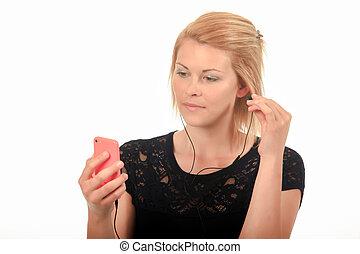 femme, à, casque à écouteurs