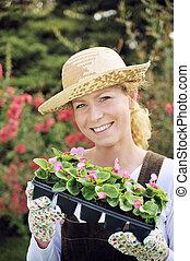 femme, à, container-grown, usines