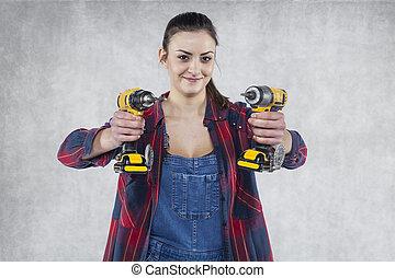 femme, électrique, ouvrier, tournevis, tenue, sourire