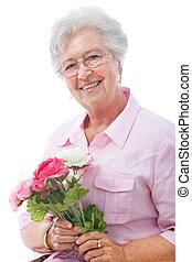 femme aînée, fleurs, tas