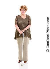 femme aînée, marchant bâton