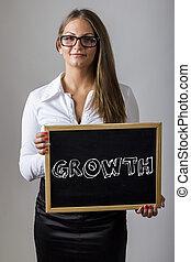 femme affaires, -, jeune, croissance, tableau, tenue, texte
