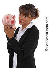 femme affaires, piggy-banque, tenue