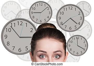 femme affaires, stands, clocks.