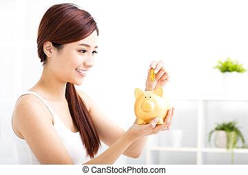 femme, argent économie, jeune, tirelire, heureux