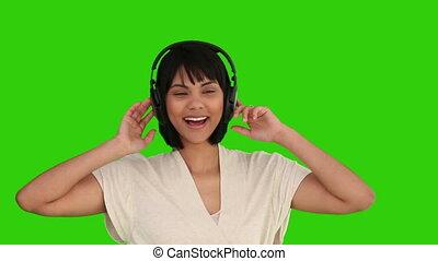 femme, asiatique, danse, écouteurs