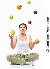 femme asiatique, jonglerie, fruits