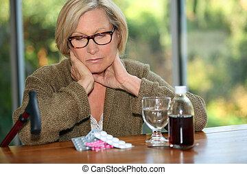 femme, assis, devant, médicament