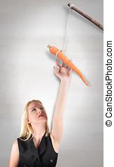 femme, bâton carotte, atteindre