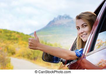 femme, chauffeur, heureux, haut, pouce, spectacles