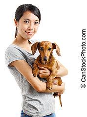 femme, chien basset allemand, asiatique