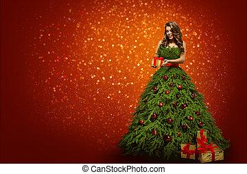 femme, dans, arbre noël, robe, tenue, présent, cadeau, mode, girl, sur, nouvel an, arrière-plan rouge