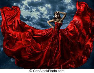femme, dans, rouges, robe soir, onduler, robe, à, voler, long, tissu, sur, artistique, ciel, fond