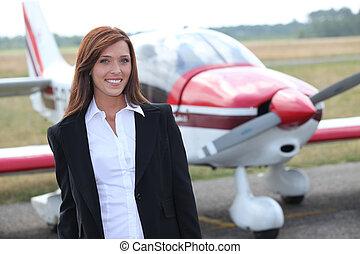 femme, devant, avion