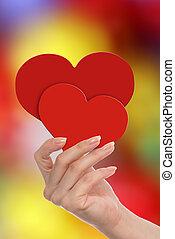 femme, elle, possession main, cœurs, rouges