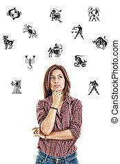 femme, entouré, à, signes zodiaque, pensivement, recherche, à