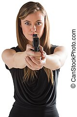 Femme fatale pointing gun at camera on white background