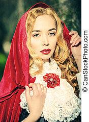 femme fatale - Portrait of a stunning blonde lady in...