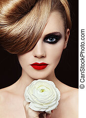 Femme fatale - Young beautiful woman with fancy hairdo and...