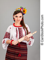 femme foyer, à, rouler, pin., femme, usures, ukrainien, robe nationale, isolé, sur, gris, fond