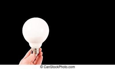 femme, grand, mat, main, ampoule, fond, lumière, tenue, blanc, noir