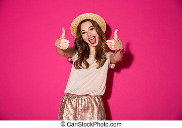 femme, haut, projection, gesture., jeune, pouces, chapeau, excité