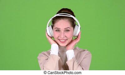 femme, headphones., mélodieux, écran, vert, chansons, écoute