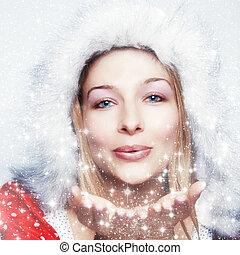 femme heureuse, flocons neige, souffler, hiver