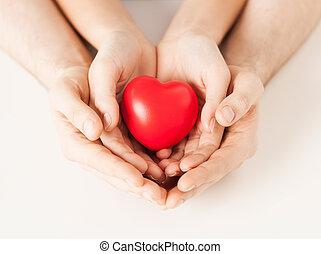 femme homme, mains, à, coeur